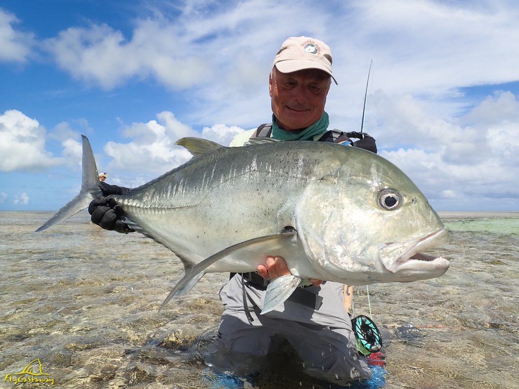 A happy angler with a flats caught GT
